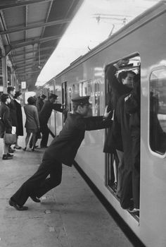 "Here at Tokyo's Shinjuku station, these guys are actually professional ""pushers."" 