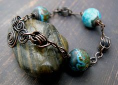 Aspects of an Unknown Planet - Venus. OOAK teal bronze copper chain maille industrial primitive artisan lampwork bracelet by PreciousViolet on Etsy https://www.etsy.com/listing/222740325/aspects-of-an-unknown-planet-venus-ooak