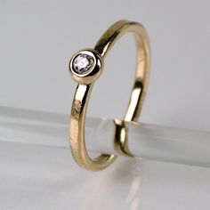 Sophies Silver - Puck, bred, ring i 18K guld, med diamant