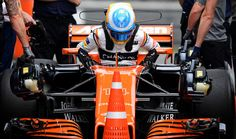 McLaren's Spanish driver Fernando Alonso steps out of his car after the third practice session for the Formula One Chinese Grand Prix in Shanghai on April 8, 2017. / AFP PHOTO / Johannes EISELE