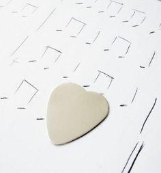 sterling heart-shaped pick