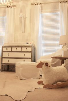 Piper Had a Little Lamb: A Restoration Hardware glider for mom and dad and a rocking lamb for baby.