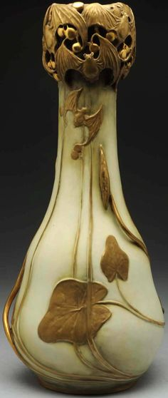 "This Amphora vase with flying bat decor features classic Art Nouveau styling. It stands 21 1/2"" tall and has both an R St. K mark and impressed Amphora oval mark under the base."