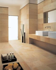 These sandstone tiles in this bathroom give the room a natural earthy look while also being elegant. Sandstone is favoured for wall claddings and flooring because of its low absorbtion rate, high compression rate and because its aesthetically pleasing. Warm Bathroom, Small Bathroom Tiles, Bathroom Tile Designs, Bathroom Renos, Modern Bathroom Design, Bathroom Interior Design, Bathroom Plans, Kitchen Tile, Bathroom Ideas