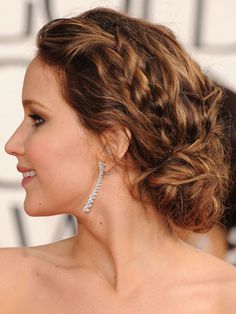 Famous Actress Jennifer Lawrence From The Hunger Game Series Movies with her chignon-curly hairdo.