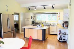 mix of contemporary and retro. great retro details in the appliances!