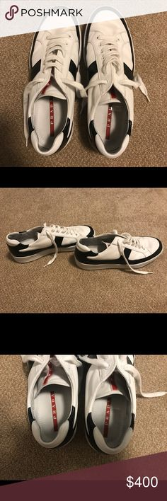 Men Prada Sneakers White prada sneakers with black details. Very comfortable- only worn twice. Sneakers are completely leather with a slight platform. GREAT CONDITION!!! Absolutely 0 stains. Offers accepted. Prada Shoes Sneakers