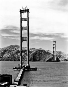 Workers complete the catwalks for the Golden Gate Bridge, hundreds of feet above the strait below, prior to spinning the bridge cables during construction on October 25, 1935. Description from historyinphotos.blogspot.co.uk. I searched for this on bing.com/images