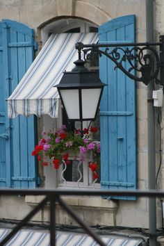 Blue shutters and striped awning