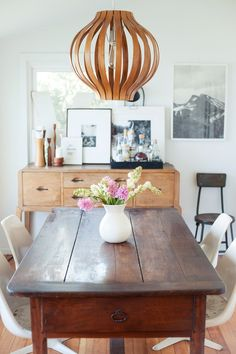 """Mingle Your Woods """"Oftentimes clients are hesitant about mixing woods in a single space, but it gives an eclectic vibe with a sense of warmth and interest. The matchy-matchy look often reads as stuffy and monotonous, lacking personality."""" — Amber Lewis of Amber Interiors #refinery29 http://www.refinery29.com/decor-solutions#slide-2"""