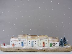 Christmas driftwood cottage sculpture with two little Christmas trees and red post box