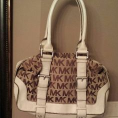 """MK bag authentic Michael by michael kors handbag. I believe this is a brookville style bag. More on large side. Authentic bag...no tears or rips.  Canvas with leather. 13"""" W x 9""""L and strap drop is 8"""" & abt 17"""" From top to bottom of bag. I LOVE TO TRADE. Wuld love a Kate Spade, LV or mayb another MK or affliction type shirts. Michael Kors Bags"""