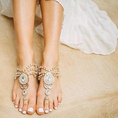 A Beautiful Pair of Barefoot Sandals for the Bride. A Fabulous Idea for Beach and Bohemian Weddings to add the finishing Touches to Your Look. Multiple Layers of Kundan Crystals Add Much Sparkle to this Barefoot Anklet Design with Gold Detail. Gypsy Boho Foot Jewelry for Weddings on the Beach and Barefoot Brides. Also a great Accessory for Nautical and Boho Style Wedding Themes.