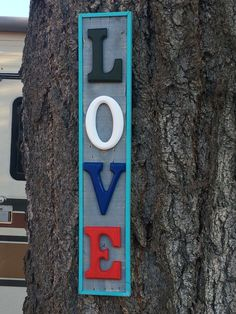 This is one of my favorites.  Made from pallet wood.  Painted then sanded, then I added the painted wooden letters and a nice border to make it pop.