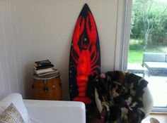 Lobster spraypainted on a surfboard by JULES DE BALINCOURT at our house in Montauk. Photo Bill Powers
