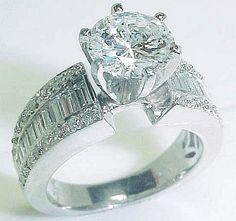large emerald cut diamond engagement ring with shield cut side diamonds in platinum jewels pinterest large engagement rings and emerald cut - Big Diamond Wedding Rings