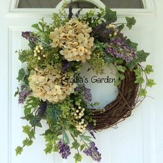Summer Door Wreath-Hydrangea Wreath-Farmhouse Decor-French Country-Cottage Chic Floral-Rustic Country Floral-Garden Wreath-Ivy Wreath This beautiful wreath design is simple but stunning nonetheless. It boasts a wonderful mixture of garden foliages, including ivy, pepper berry and hanging vines. A pair of cream hydrangeas is the focal point, joined by flocked purple heather, lavender caspia, and clusters of creamy white berries. This design would look lovely on your front door, or perhaps as…