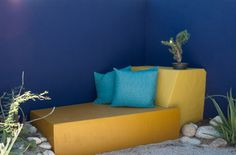 Bold strokes of cobalt blue and golden yellow set this space apart as a refuge from the intense Arizona sun. A built-in chaise provides a co...