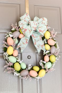 DIY Easter Egg Wreath - create a beautiful Spring wreath with easter eggs, moss, and flowers. Add a pink and mint floral bow and you have a pretty DIY Easter egg wreath to welcome guests. Hoppy Easter, Easter Eggs, Easter Table, Easter Bunny, Diy Easter Decorations, Easter Wreaths Diy, Outdoor Decorations, Thanksgiving Decorations, Homemade Decorations