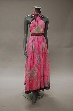 Pierre Balmain couture printed organza gown and stole, circa 1970, labelled and numbered indistinctly, the bodice attached to the fitted collar, matching triangular shawl and belt in tartan print in shades of mauve-pink.