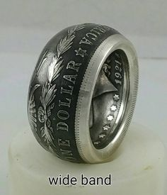 This is a silver Morgan Silver Dollar coin ring. This is a large coin that makes a very impressive ring. Your choice of