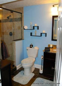 Black and white tile bathroom ideas bathrooms valspar for Blue and black bathroom ideas