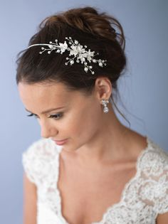 Most Popular! Bridal headband features hand-wired soft white pearls and rhinestones that encircle brushed silver leaves in a delicate botanical design.