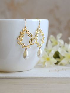 Gorgeous gold plated laurel wreath and Ivory teardrop pearl earrings. Tarnish resistant gold plated laurel wreath pendants have beautiful details