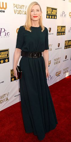 Critics' Choice: All the Glam Red Carpet Looks | CATE BLANCHETT | Editors here will be talking about Cate's flawless hair and makeup for weeks, but for now, let's focus on what she's wearing: a loose-fitting deep-green dress, cinched at the waist with a bejeweled wide belt and a matching box clutch.