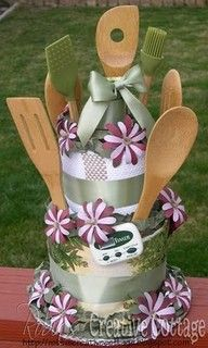 Bridal shower display: Towel cake w/ kitchen utensils for the bride to keep
