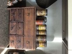 Collection of spice tins on a small cabinet in the kitchen.