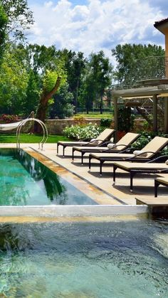 Kick back by this outdoor Italian pool on a lounger or a hammock.