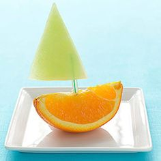 This fruity treat is sure to make a splash with your kids. To Make: Cut piece of honeydew melon into the shape of a triangle. Cut an orange into wedges. Push one end of a small straw into the melon and the other into an orange wedge. Cute Food, Good Food, Boite A Lunch, Childrens Meals, Edible Creations, Summer Snacks, Snacks Für Party, Food Humor, Kid Friendly Meals