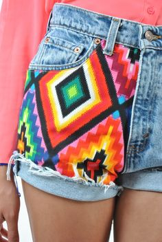 fabric sewn onto jean shorts...this intrigues me.  (great way to cover up a hole)