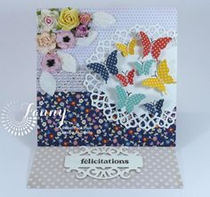 Flowers and butterflies - Scrapbook.com - Beautiful die cutting creates a delicate look on this card.