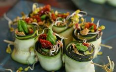 <p>These colorful zucchini rolls are the ideal finger food to put out at a party because they look gorgeous and taste great too. The fresh, raw zucchini are salted and then smeared with sunflower pate and finally, stuffed with sun-dried tomatoes, radish sprouts, and a fresh basil leaf.</p>
