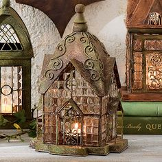 """Historic English architecture inspires these intricately constructed lanterns. Lead solder creates lacy fretwork frames for beveled glass windows which brilliantly reflect light. Open latched door to insert a tea light or votive (not included). Indoor or outdoor use. Sizes range from 4"""" sq. - 6"""" sq. x 9 1/8""""-11 1/2""""H"""