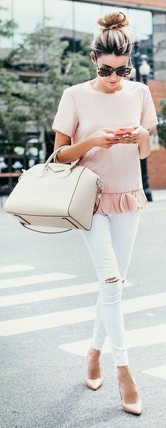 Pink ruffled hem top, white ripped jeans, pink heels, and cream handbag
