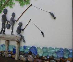 Items similar to Grandfather and Grandsons Fishing Fun on Etsy - BOIS DE GRÈVE - This is a very special piece that gives a glimpse into the bond shared by a grandfather and his pre - Driftwood Crafts, Seashell Crafts, Beach Crafts, Seashell Art, Stone Pictures Pebble Art, Stone Art, Sea Glass Crafts, Sea Glass Art, Stone Crafts