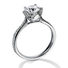 Engagement ring by Furrer-Jacot features 28 F-G brilliant cut diamonds at 0.104 carat weight. Starting at $2,420, also available in platinum.More about Furrer-Jacot...