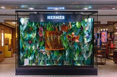 For its Carte Blanche, the Hermès store at Hong Kong International Airport is exhibiting a piece by the French artists Zim&Zou, 'The Eternal Jungle', which is an invitation into the wild.The window installation creates an intriguing contrast between… Window Display Design, Shop Window Displays, Store Displays, Tropical Windows, Hermes Window, Hermes Store, Theme Nature, Design Textile, Retail Windows