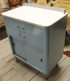 Vintage blue and white metal medical cabinet. most like the one I have