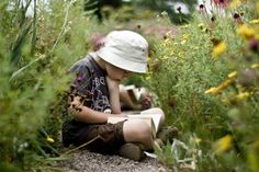 reading in the flowers.   by S V Giles