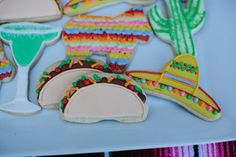 Fiesta birthday party iced cookies, Taco shaped sugar cookies, Margarita shaped sugar cookies, Birthday party cookies, Fiesta first birthday party, Cinco de Mayo theme party, Kids party theme ideas, How to throw a fiesta party, Cinco de  Mayo party inspiration, Fiesta first birthday party, Uno birthday party, Kids birthday party, Fiesta party details, Gender neural kids birthday party ideas