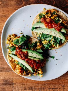 Breakfast Tacos: Scrambled eggs with spinach, topped with salsa and fresh avocados all on a corn tortilla (yum!)