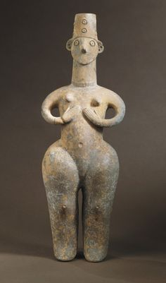 Female Figure Northern Iran, circa 1350-800 B.C. Sculpture Reddish-brown burnished ware Height: 13 1/2 in. (34.3 cm); Length: 4 1/8 in. (10.6 cm) Gift of Nasli M. Heeramaneck (M.76.174.182) Art of the Ancient Near East