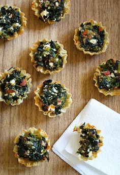 These bite-sized spinach pies are a fun twist on one of my favorite Greek dishes, Spanakopita. These are great appetizers for the Holidays, football games, or anytime you get together with friends and family.  Delicious and simple to make. You can make the filling a day ahead then assemble and bake right before serving. The shells can be found in the freezer section, and now they make them already baked.      Mini Greek Spinach Pies Skinnytaste.com Servings: 15 • Size: 2 mini pies • Points…