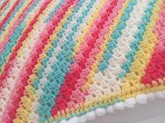 Corner to corner pram blanket using sherbet variegated yarn and Pom Pom edging! #pompoms #crochet #cornertocorner #c2c