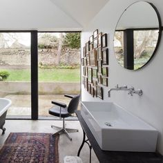 The Providence Chapel in Wiltshire by Jonathan Tuckey Design is a perfect marriage between an old chapel and a clean, modern architectural extension. House, House Bathroom, Wiltshire, Modern House, Property Design, Chapel Conversion, Fancy Bathroom, Yellow Bathrooms, Bathroom Decor