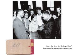Joan Mulholland (first white member of Delta Sigma Theta Sorority, Inc.) getting Dr. Martin Luther King's autograph during his visit to Tougaloo College.